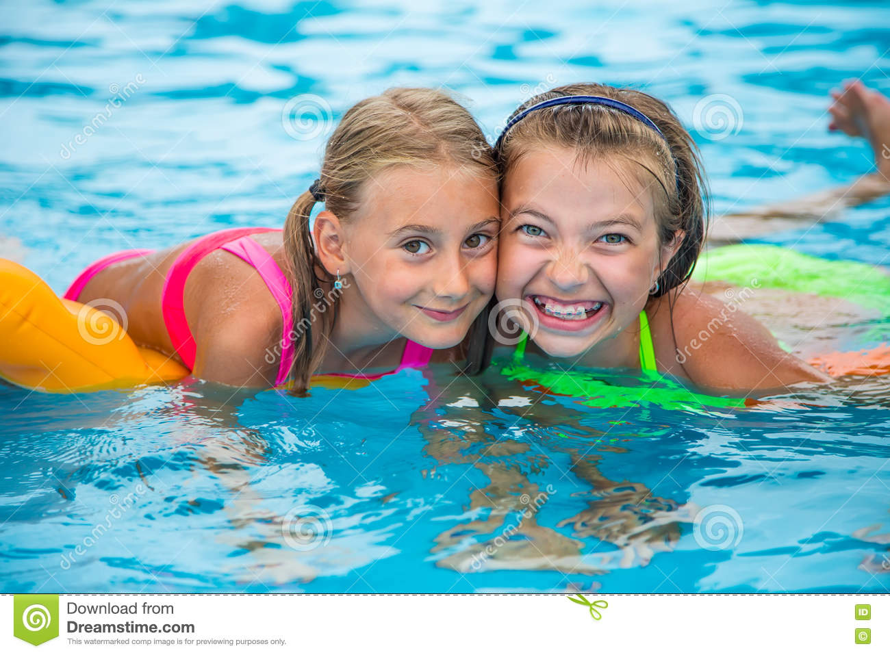 Two Happy Girls Playing In The Pool On A Sunny Day Cute Little Girls Enjoying Holiday Vacation