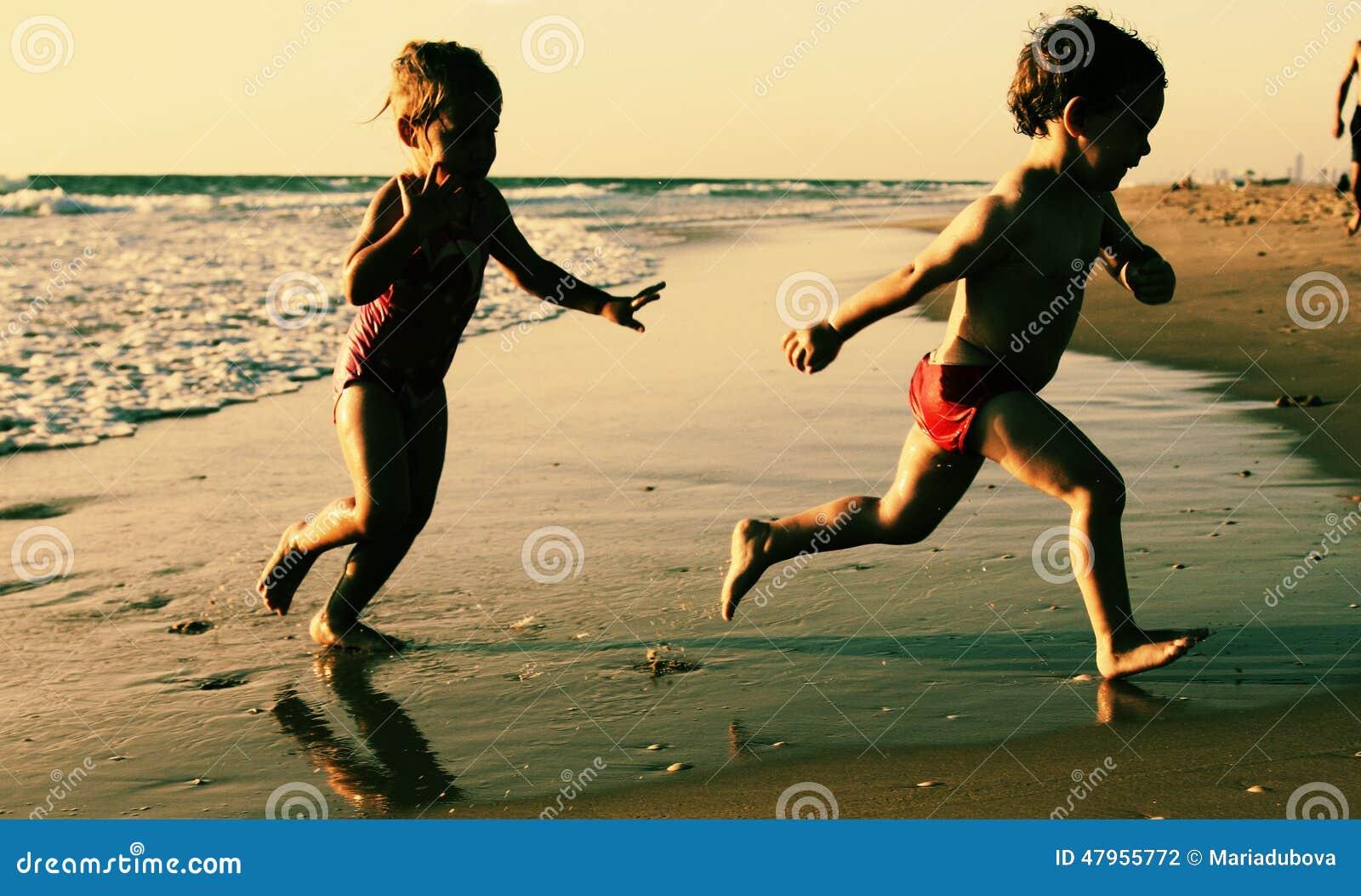 Kids Playing At The Beach Stock Photo | CartoonDealer.com ...