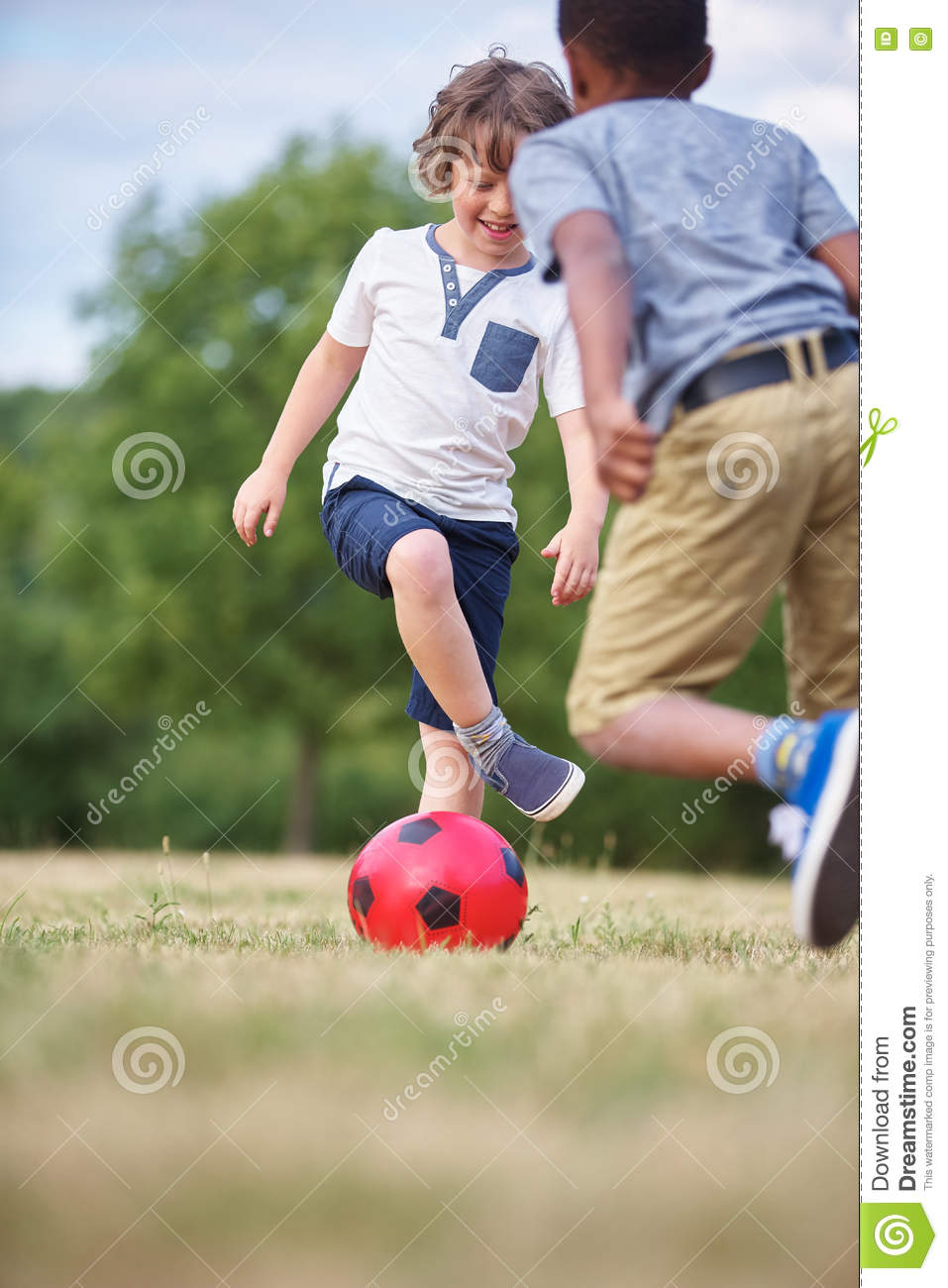 Two happy kids playing soccer