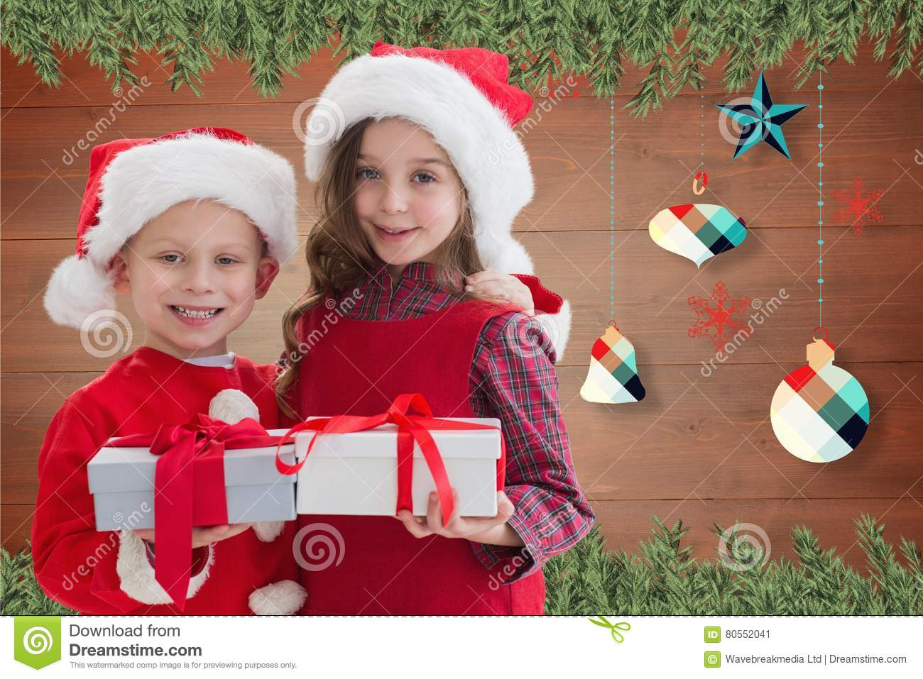Two Happy Kids In Santa Costume Holding A Christmas Gift Stock Image ...