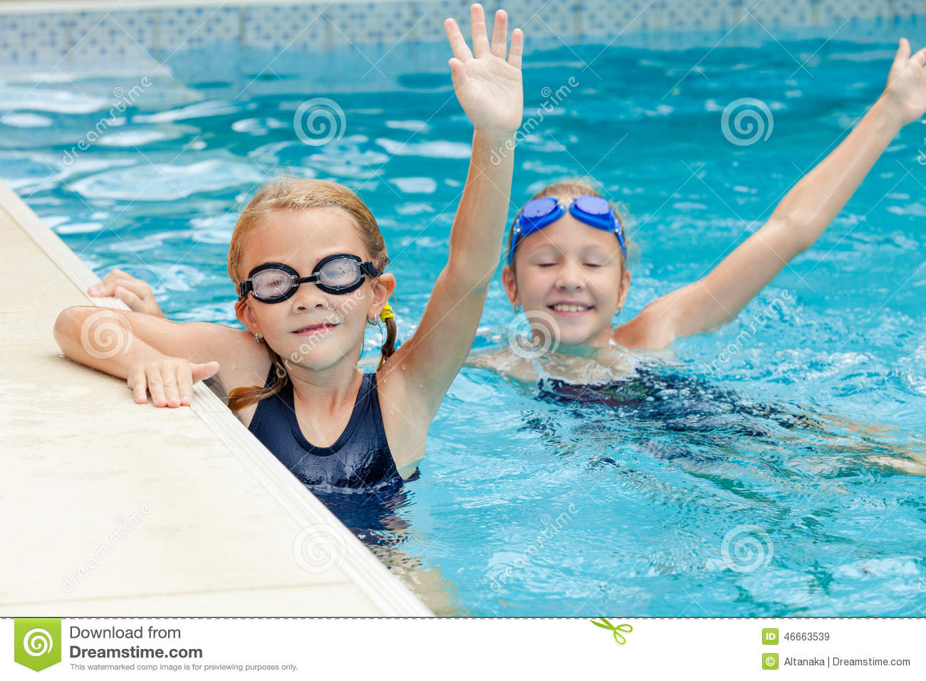 Two happy little girls playing in the swimming pool stock for Pool time pools