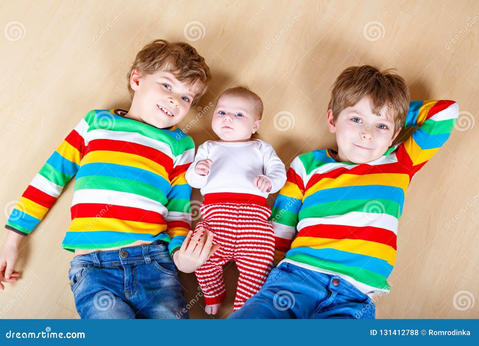 5e0c7a80a Two Happy Little Preschool Kids Boys With Newborn Baby Girl