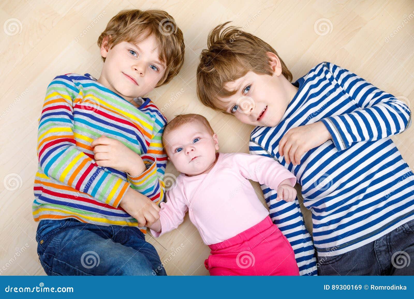 3966e5f09 Two Happy Little Preschool Kids Boys With Newborn Baby Girl Stock ...