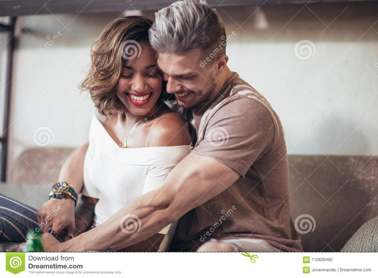 1d15c196d574 Two happy mixed race couple having fun at the coffee shop. Couple enjoying  at a coffee shop