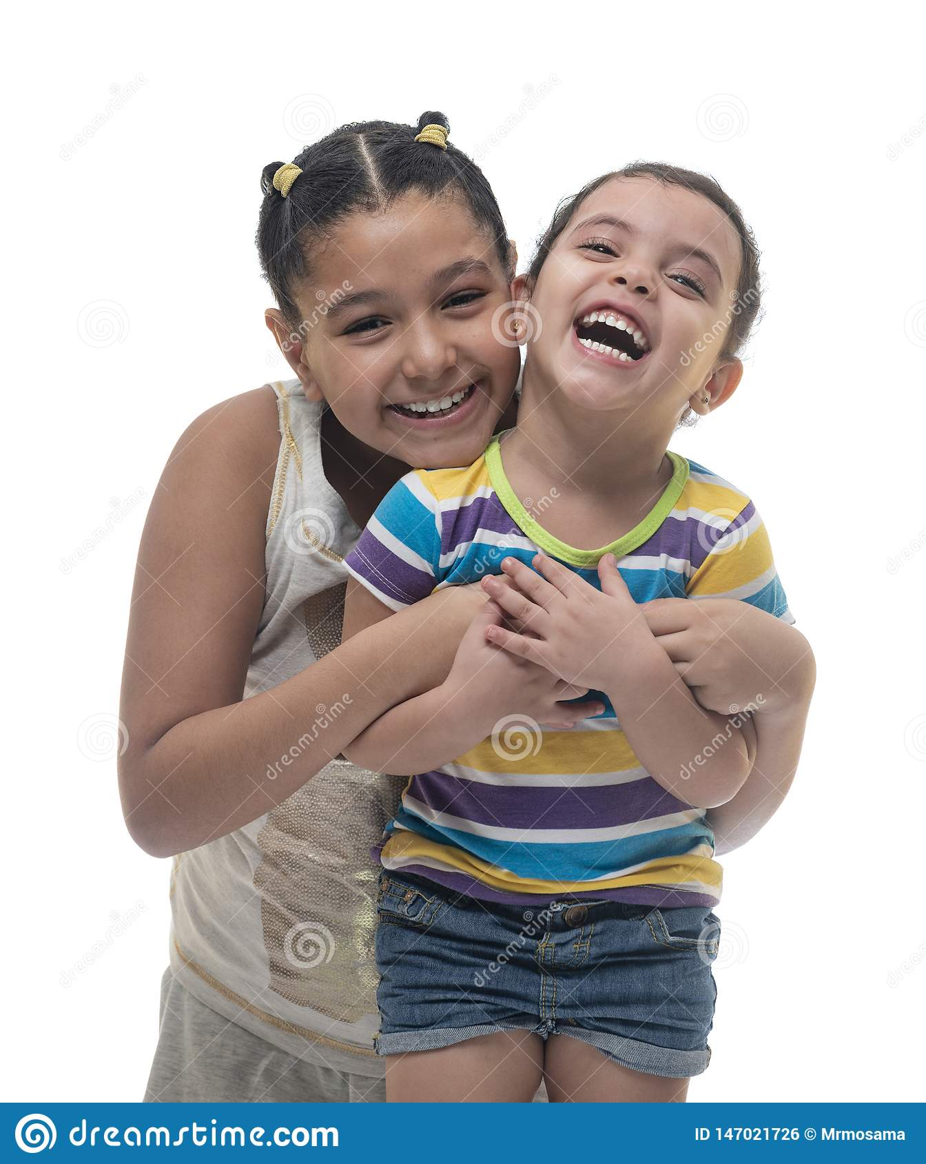 Two Happy Sisters, Older and Younger, with a Laugh Full of Joy on White