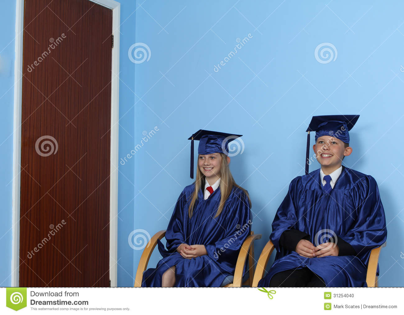 Two Happy Students Sitting On Chair Stock Photo Image