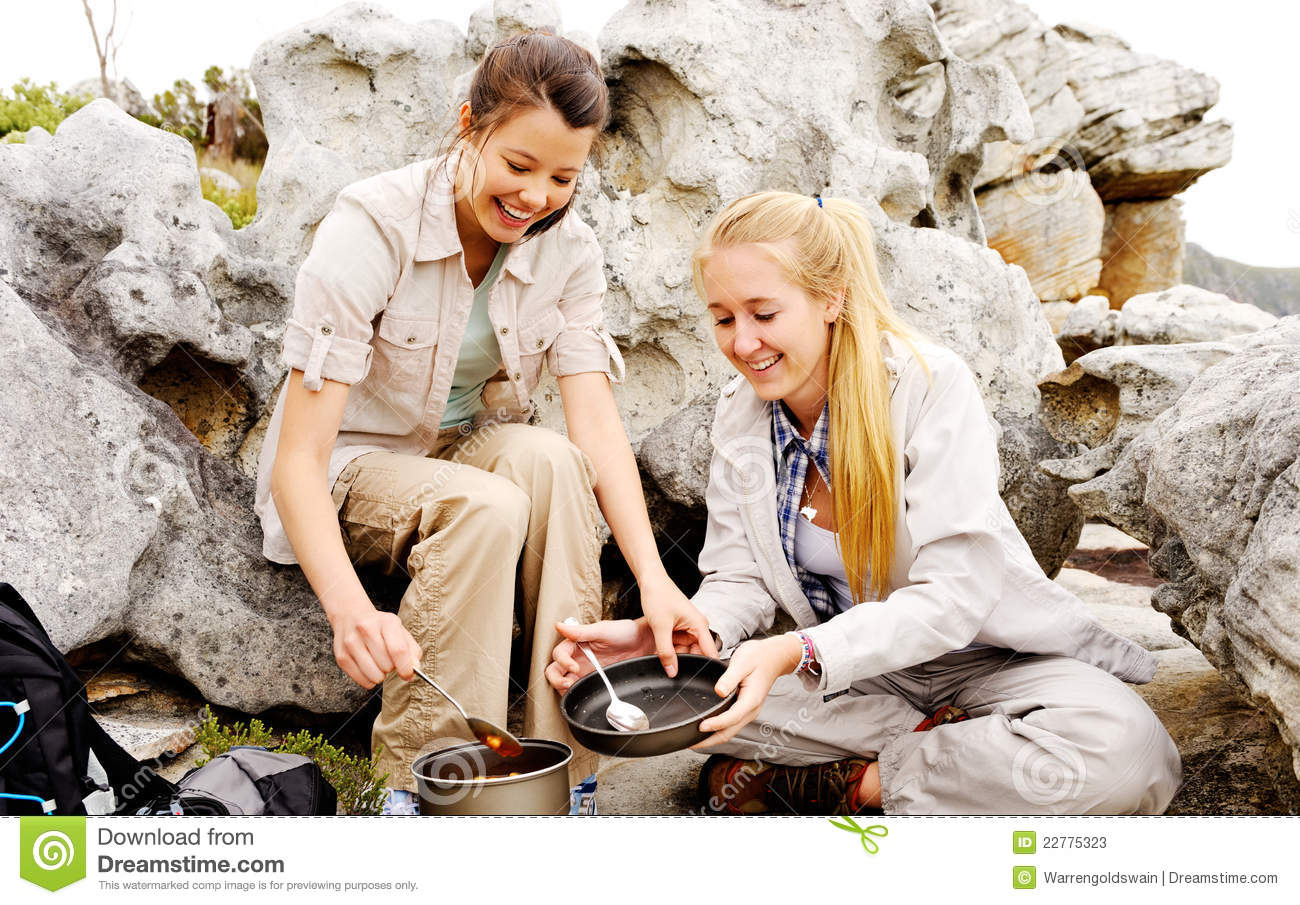 Two happy women cooks outdoors
