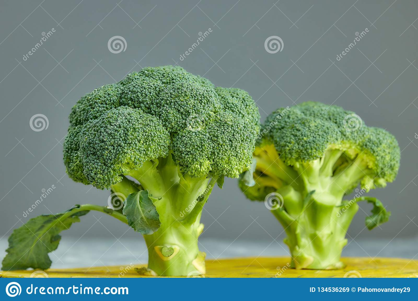 Two heads of healthy salad. fresh green broccoli. horizontal view of green vegetable flower. healthy diet.. green cabbage close-up. Two heads of healthy salad royalty free stock images
