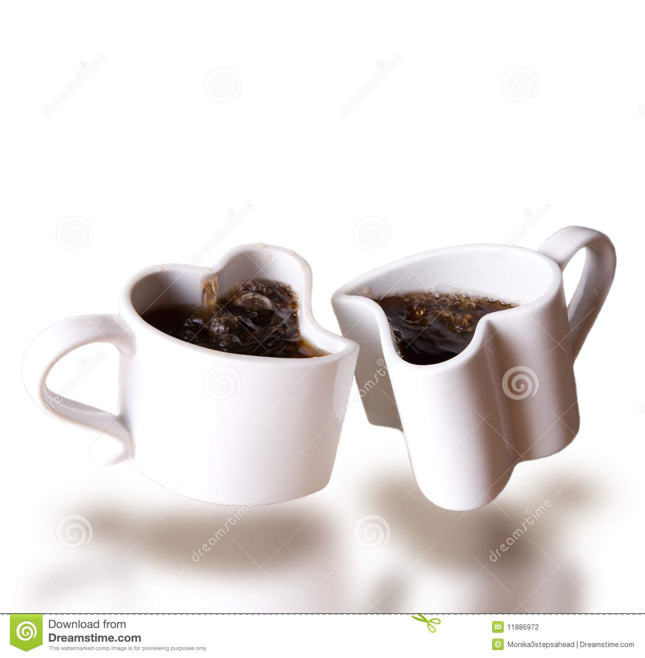 Two Heart Shaped Love Cups Of Coffee Levitating Stock