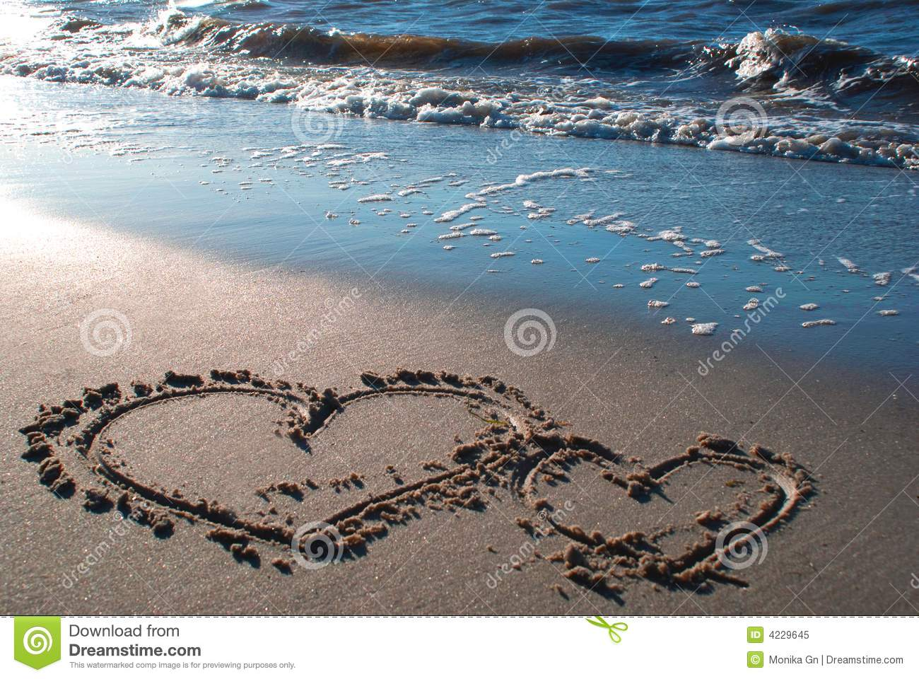 Two hearts on the beach 2