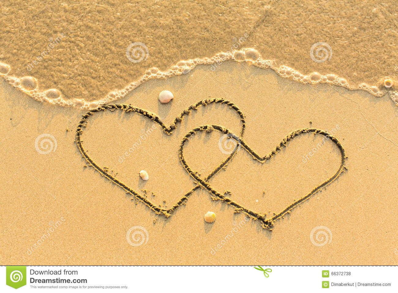 Two Hearts Drawn On The Sand Of A Beach. Love. Stock Photo ...