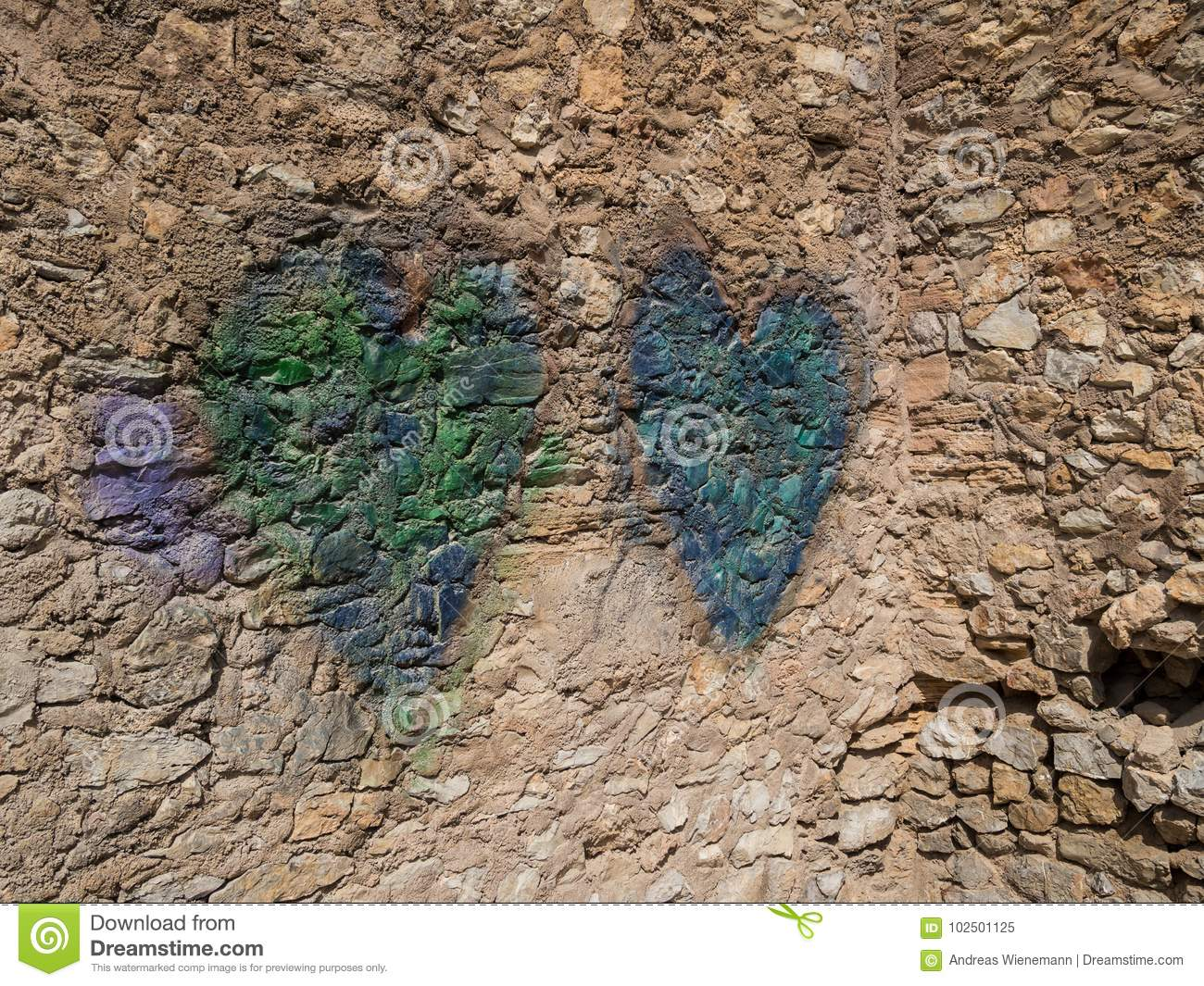 Two hearts on a natural stone wall, arta, mallorca