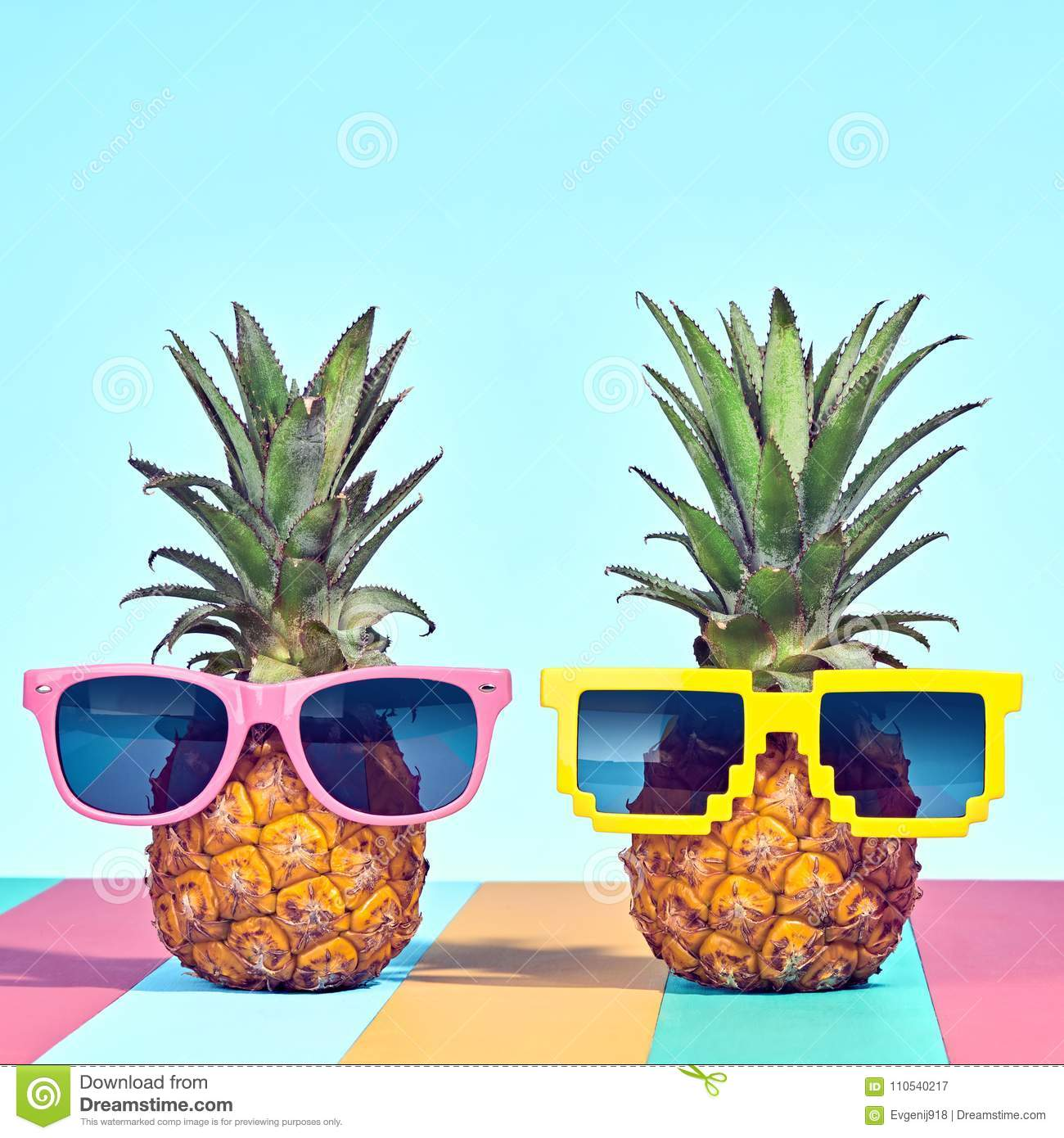 Two Hipster Pineapple In Sunglasses On Beach Stock Image