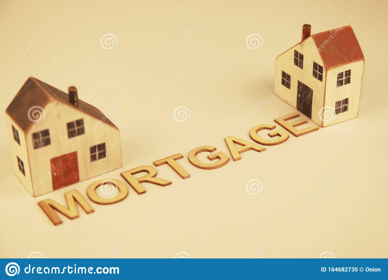 two-homes-mortgages-being-repaid-over-many-years-word-mortgage-164682735.jpg?profile=RESIZE_400x