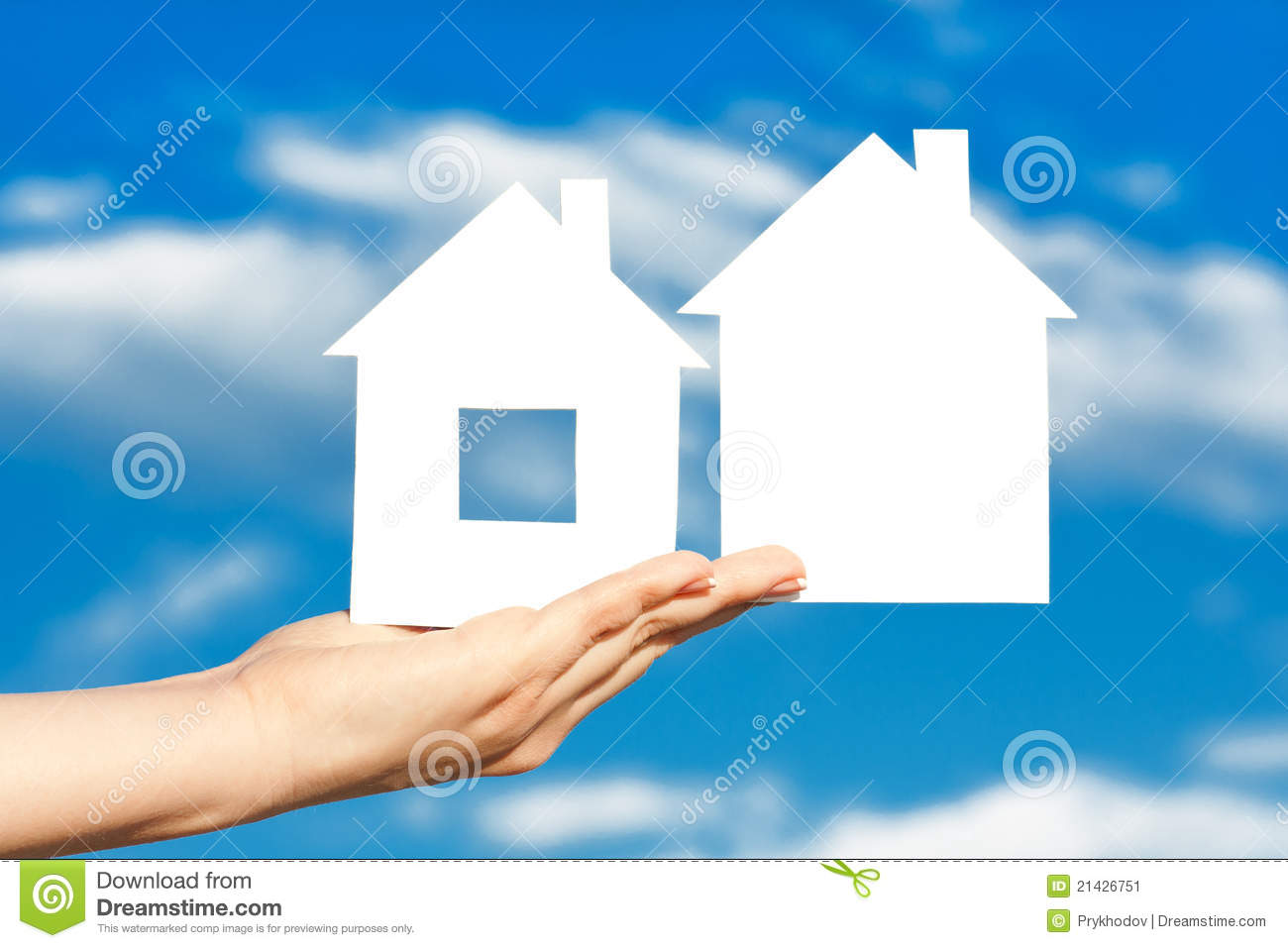 Two houses on the hand on blue sky