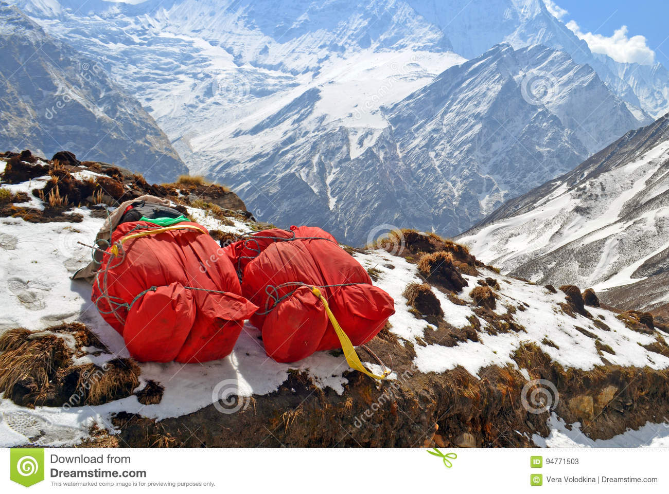 Two huge red backpacks for mountain expedition on snow. Porter Mountaineering equipment.