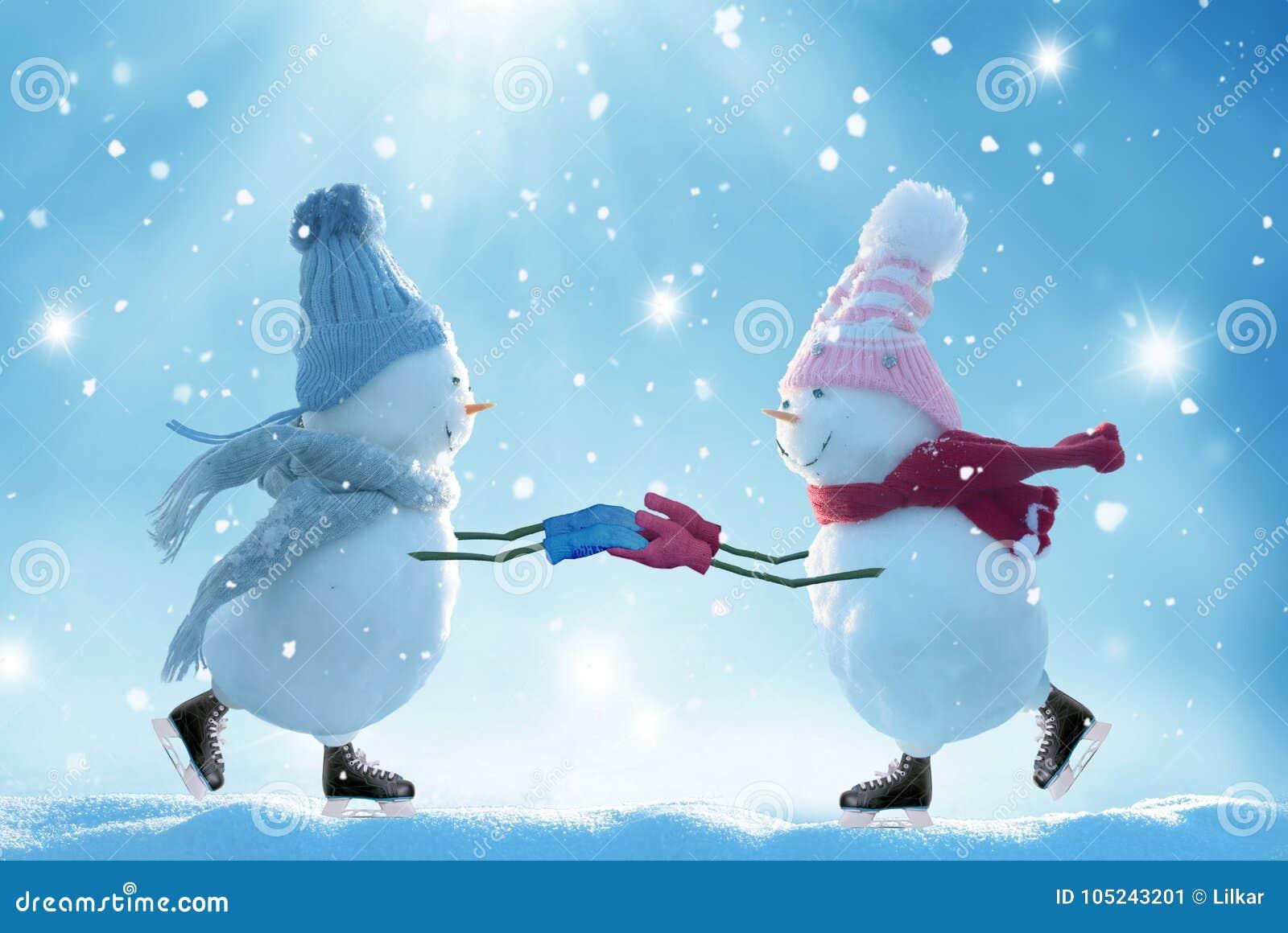 Two ice skating snowmen