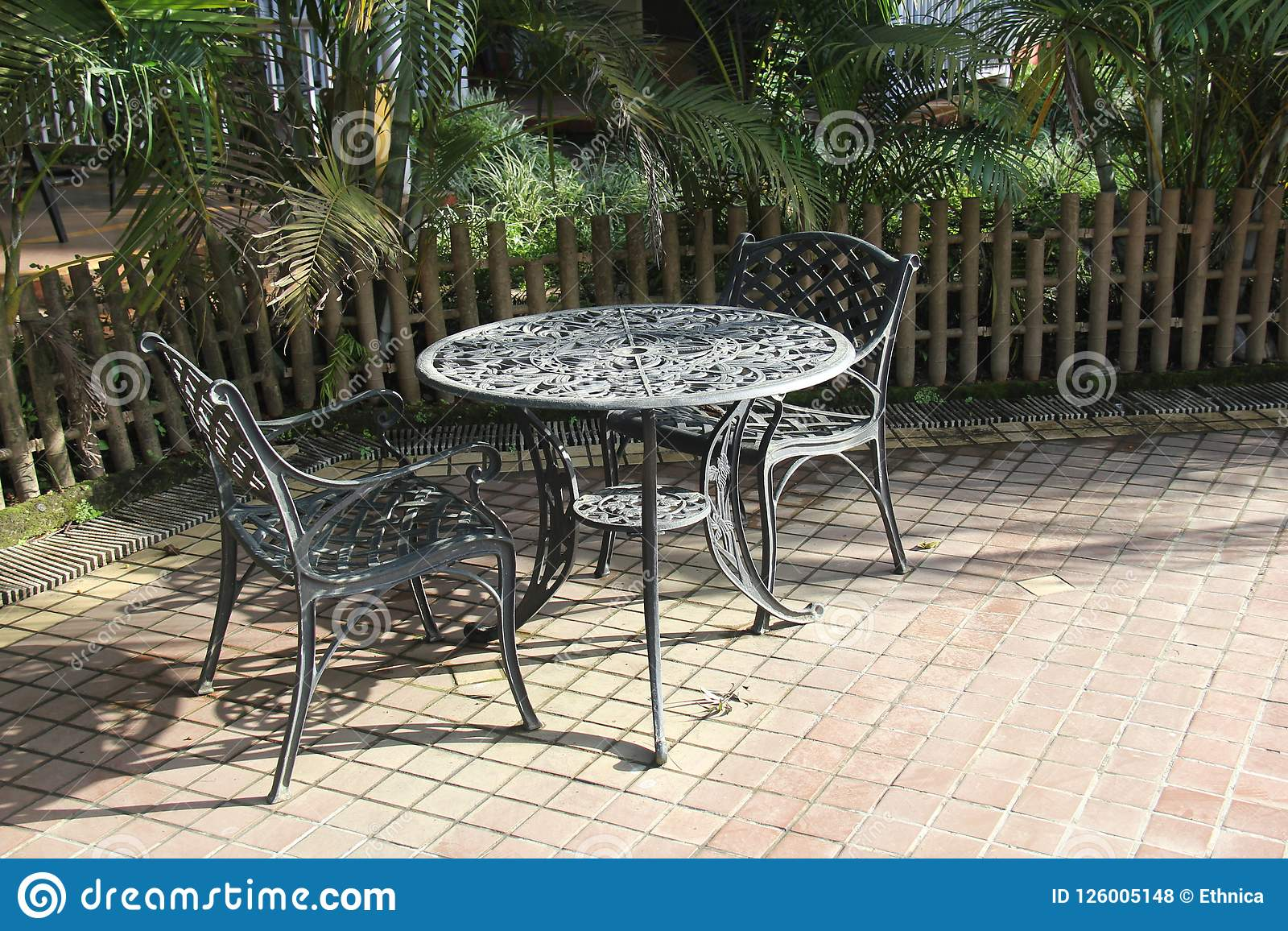 Picture of: Two Iron Chairs With Round Table In The Garden Stock Photo Image Of Leaf Meeting 126005148