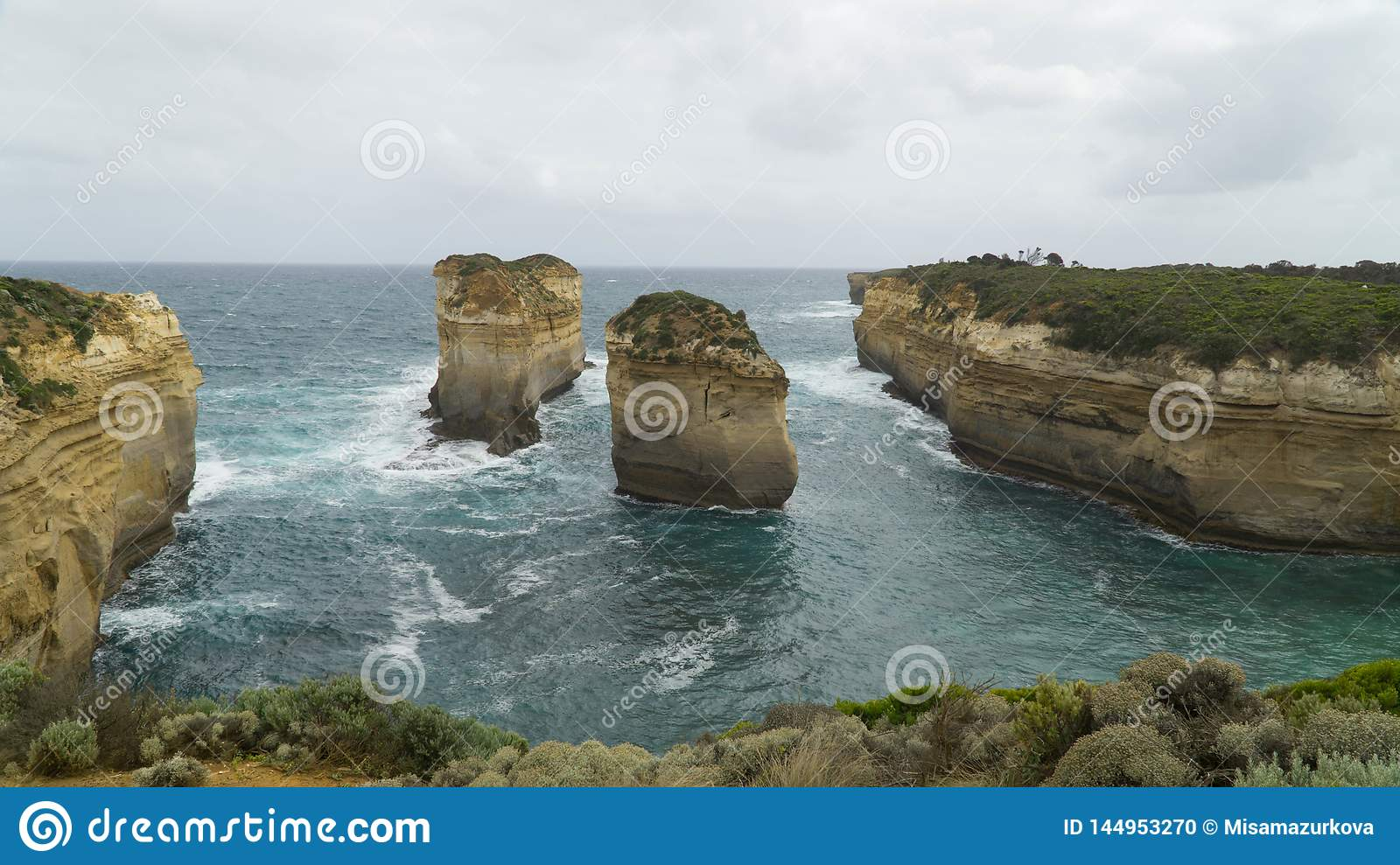 Two isolated cliffs and rock formations along The Great Ocean Road, caused by water erosion, Australia