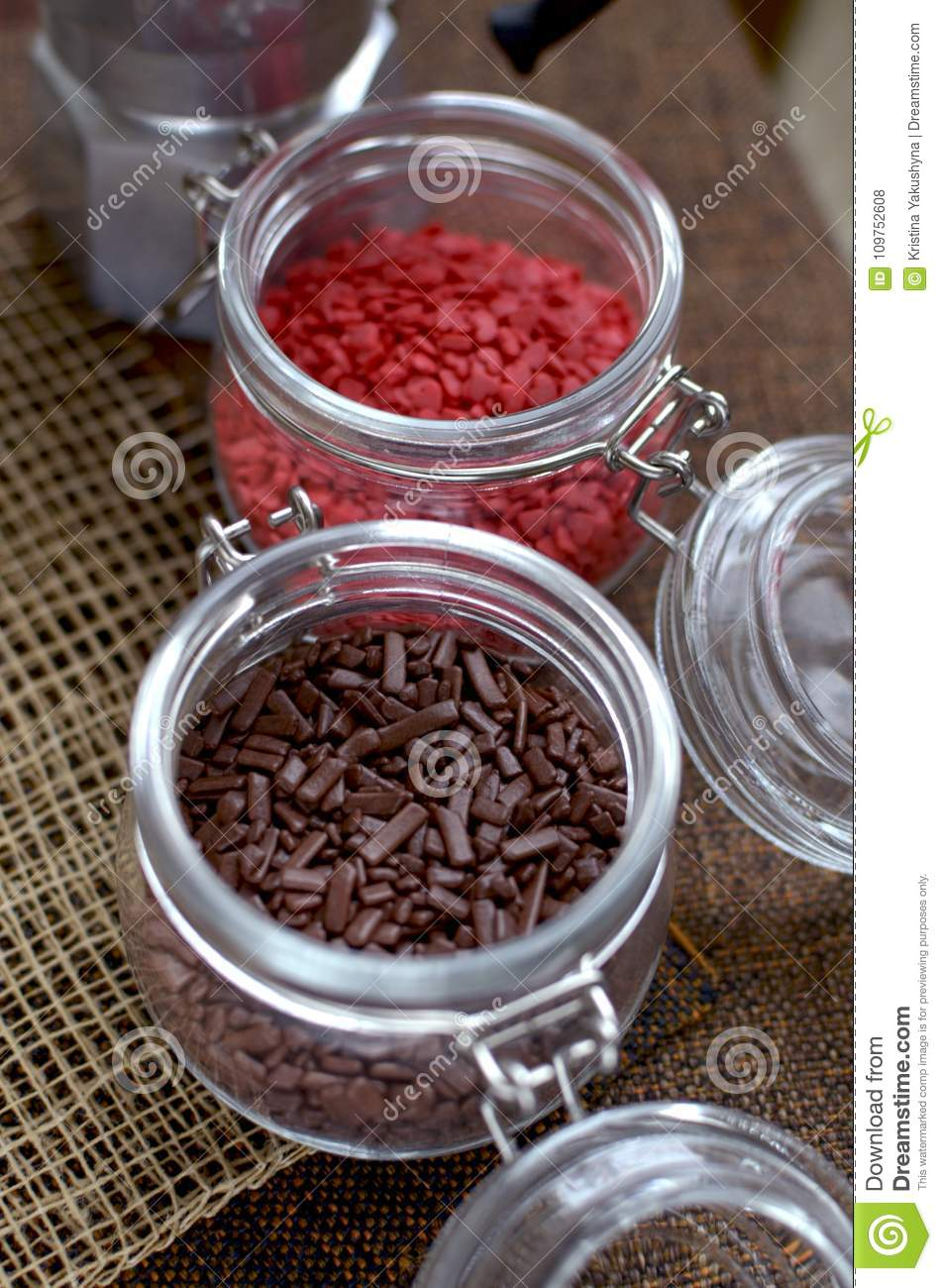 Two jars with sugar confectionery additives