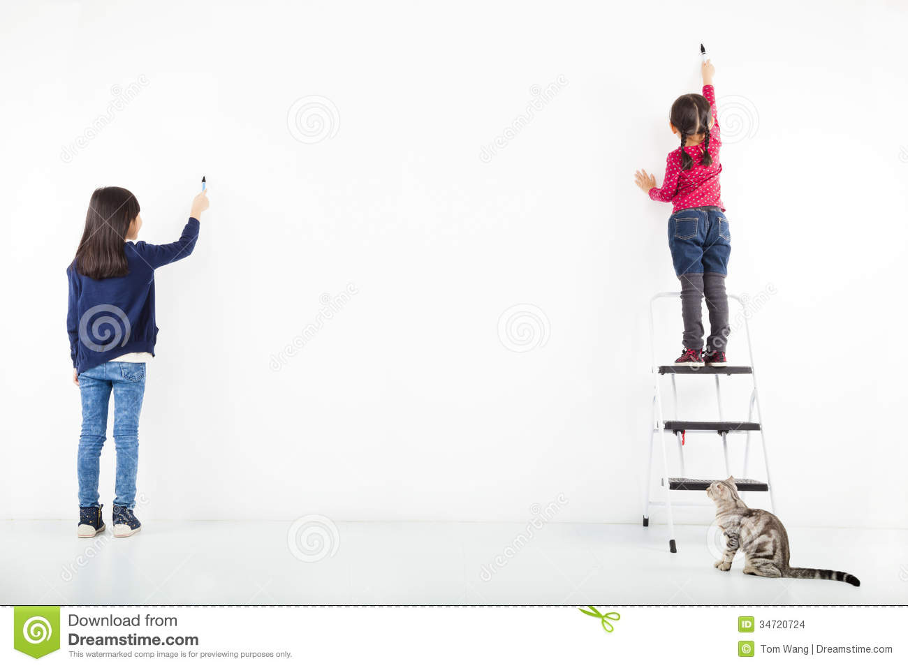 Kids drawing on the blank white wall stock images image 34720724