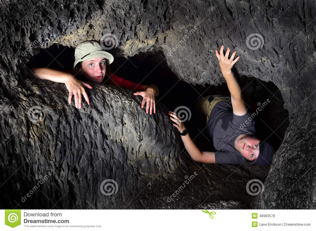 Two Kids Exploring Cave