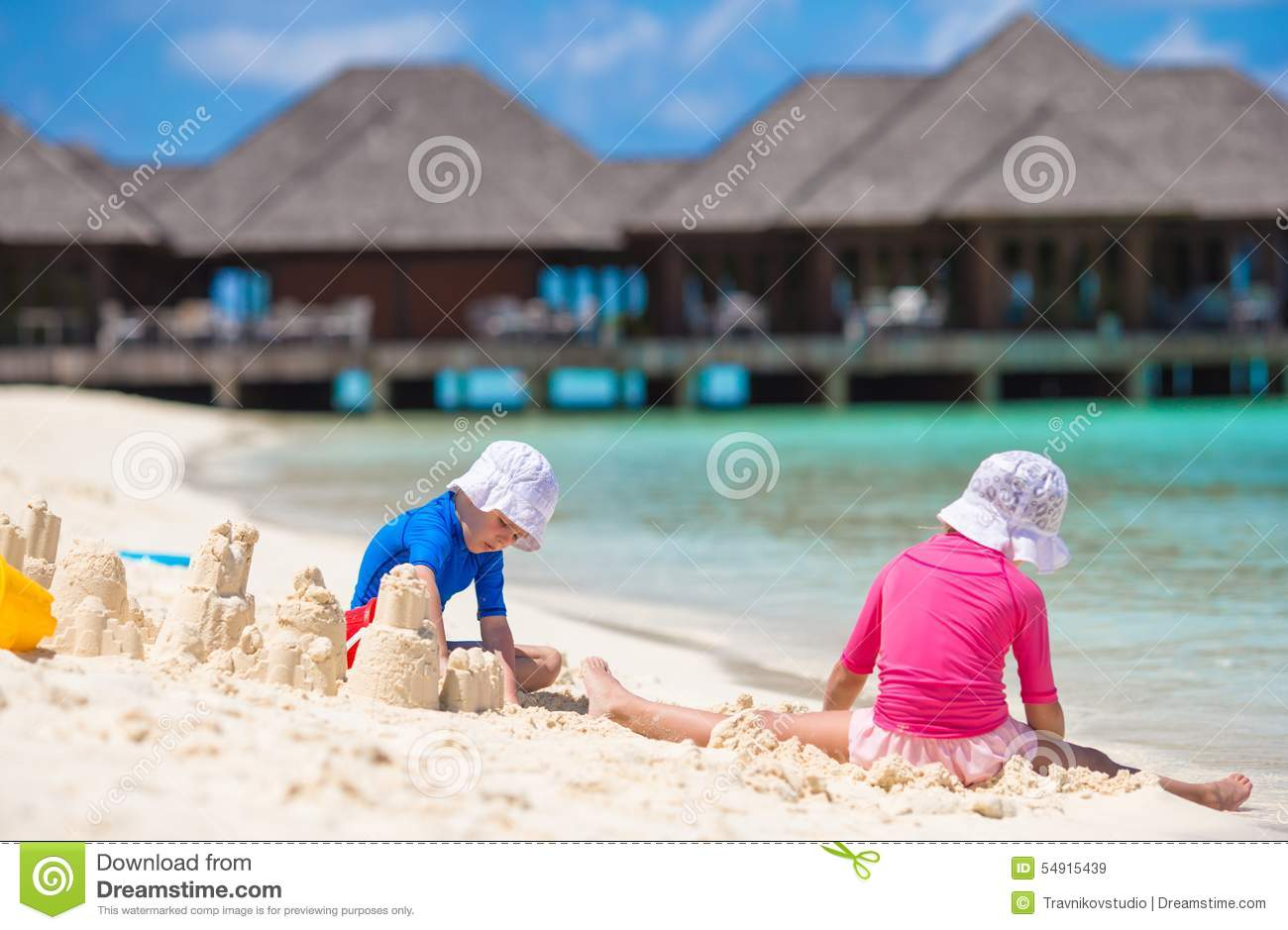 Beach Toys For Girls : Two kids making sand castle and playing at stock image