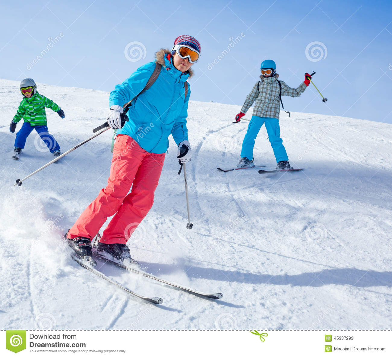 Two kids with mother enjoying winter vacations stock for Winter vacations in the us