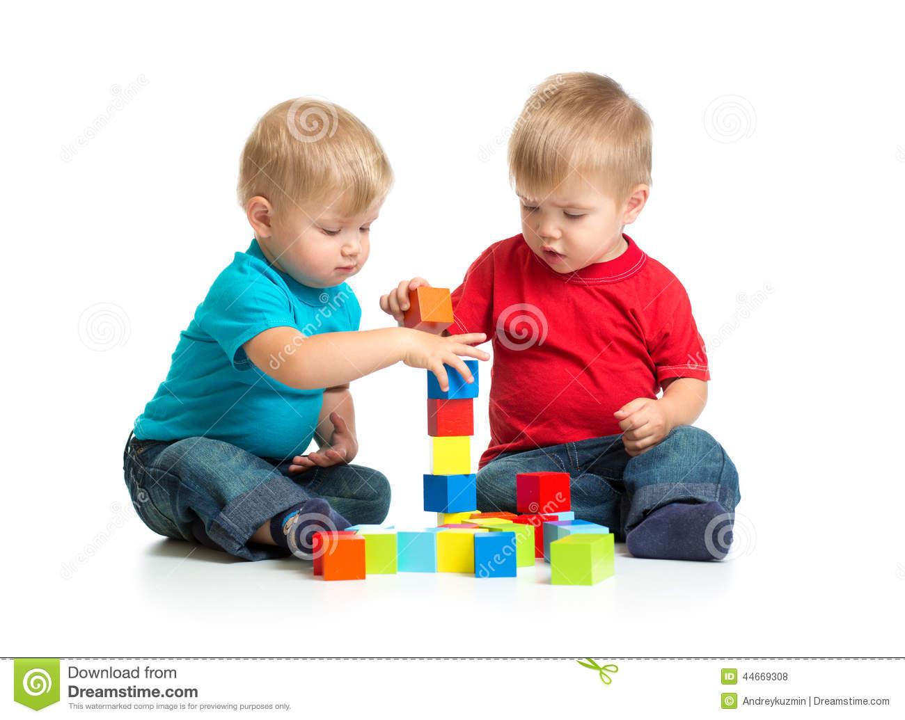 two kids playing wooden blocks building tower stock photo