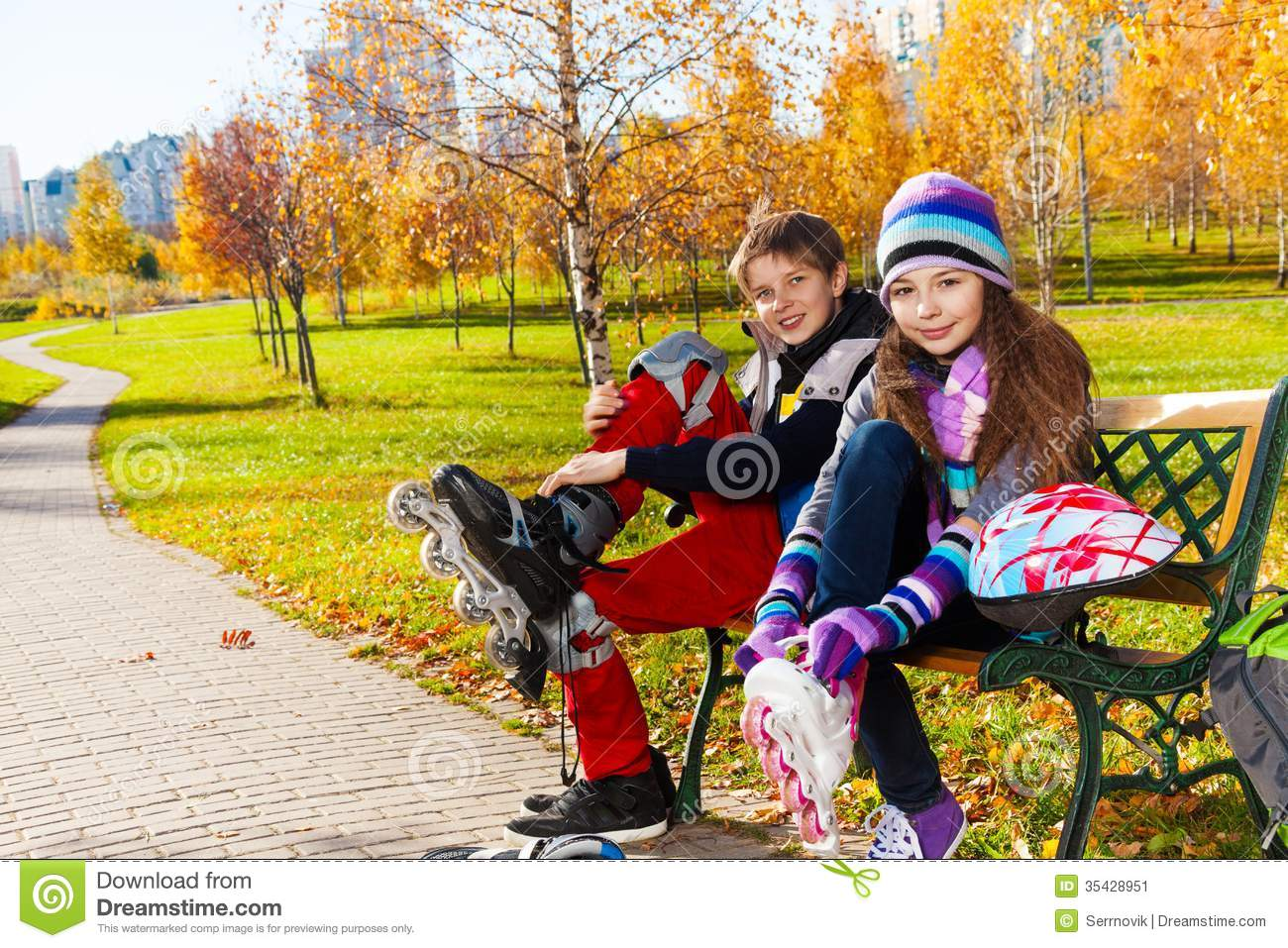 Two Kids Putting On Roller Blades Stock Image - Image ...