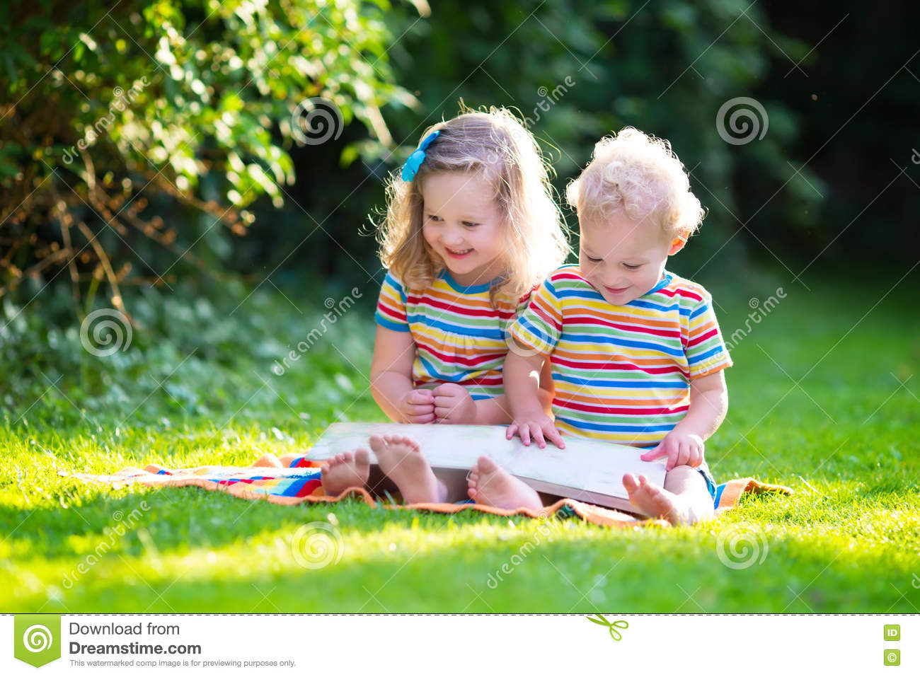Two kids reading in summer garden stock image image for Childrens play yard