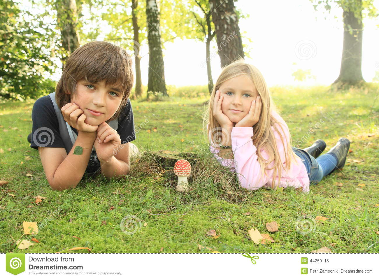 Two kids with red toadstool