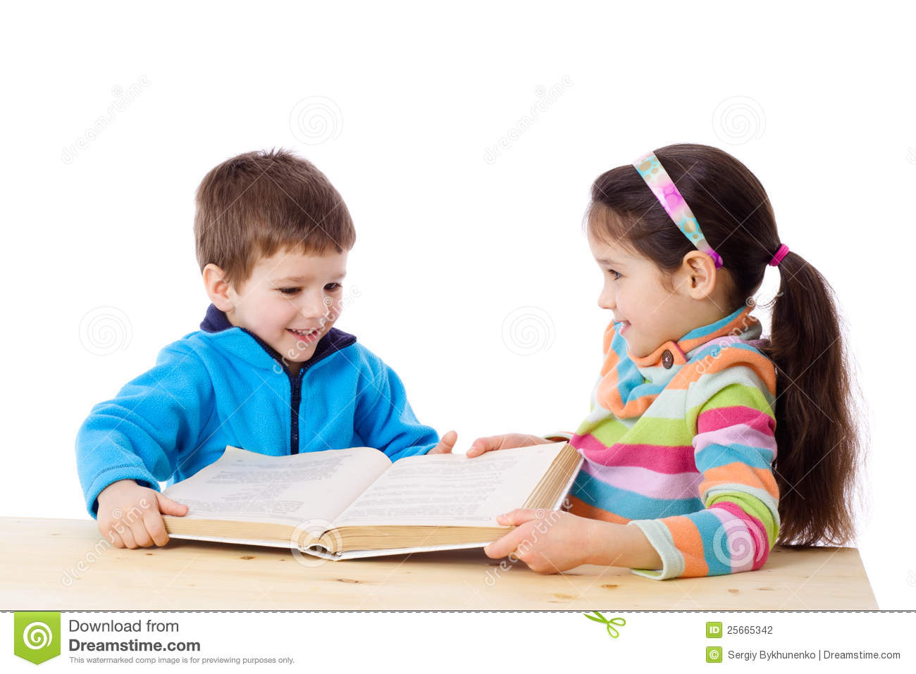Two kids sharing the book stock photo. Image of enjoying ...