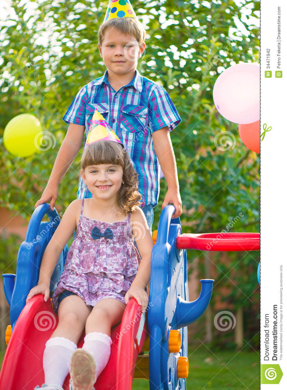 Two Kids Sliding At Playground Stock Photo - Image: 34471942