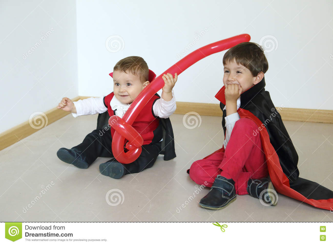 Two kids with vampire costume enyoing in a party