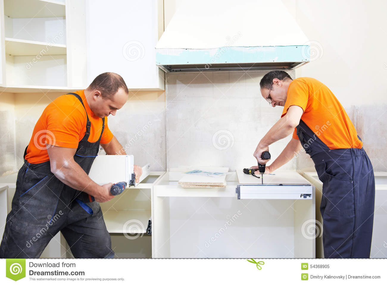 Two kitchen installers at carpenter work stock image image 54368905 - Furnitur photos ...