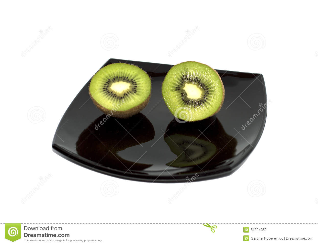 Two kiwis on a black plate, the top view