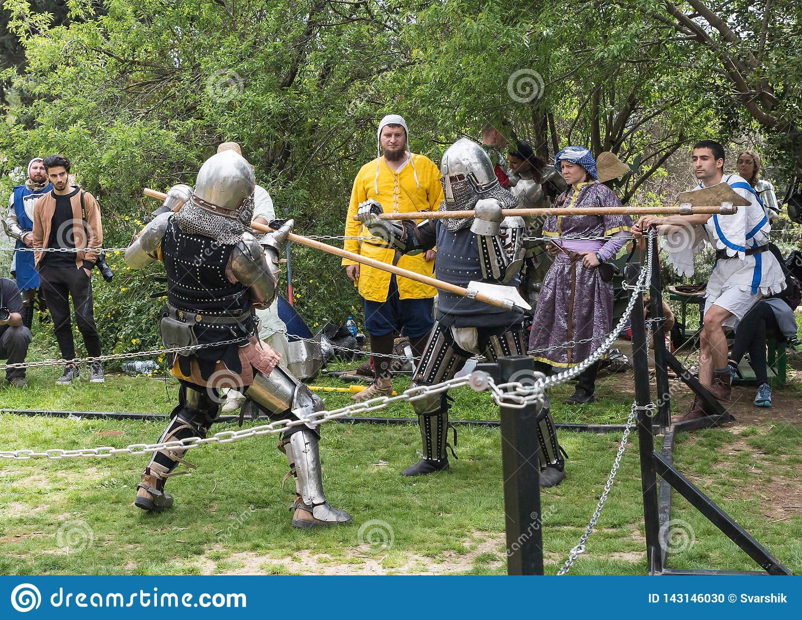 Two Knights With Halberds Fight In The Ring At The Purim