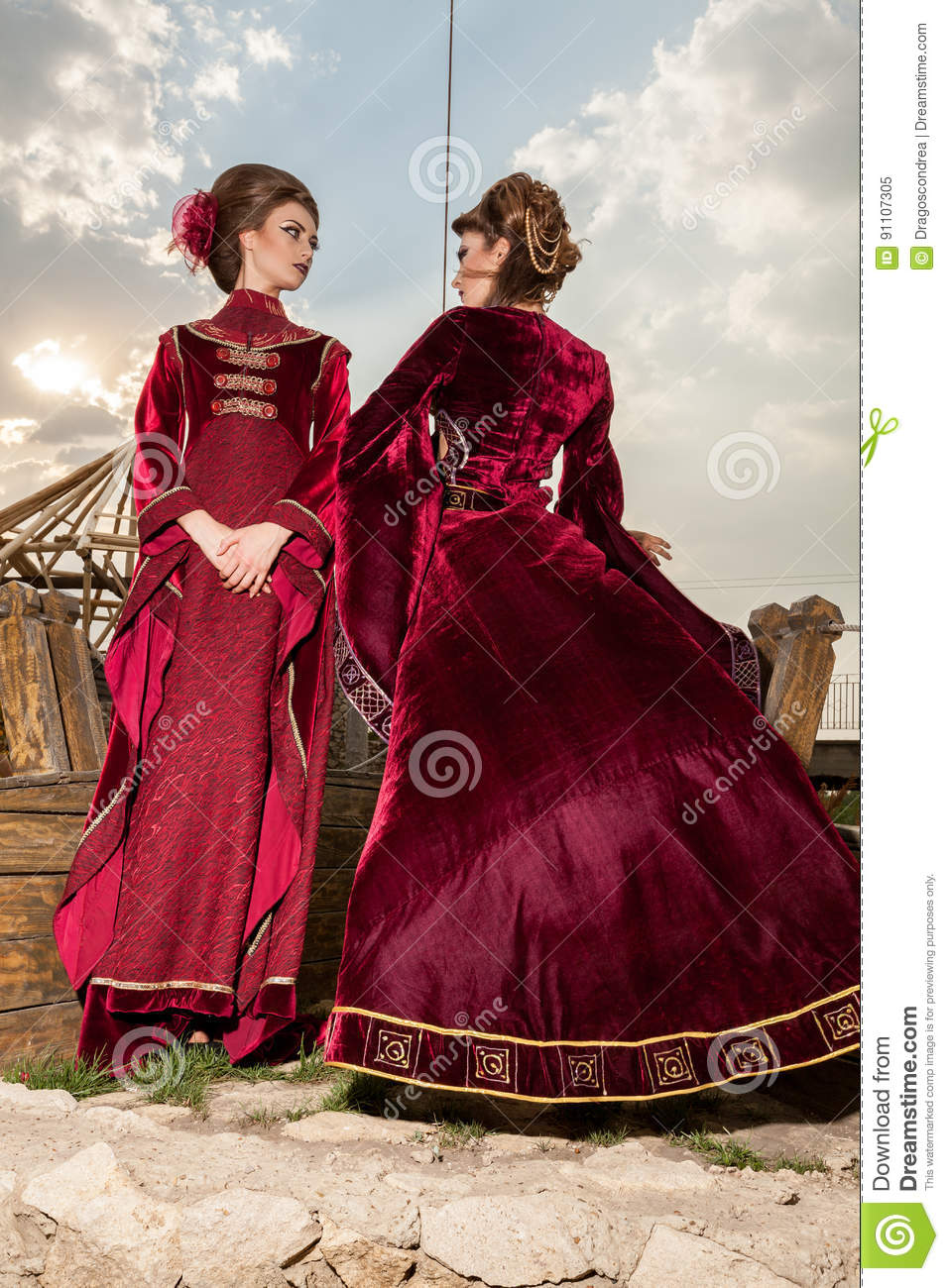 two in luxury vintage clothes on a boat stock photo