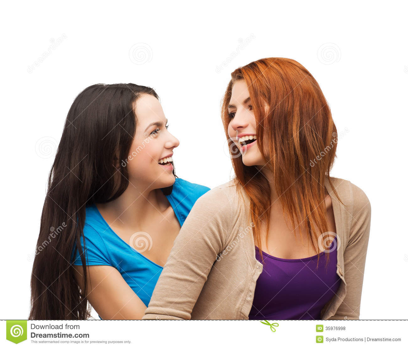 Two Laughing Girls Looking At Each Other Stock Photo