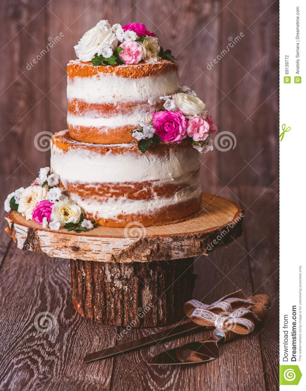 wedding cake with flowers in between layers vintage wooden table with the wedding cake 2 stock photo 26882