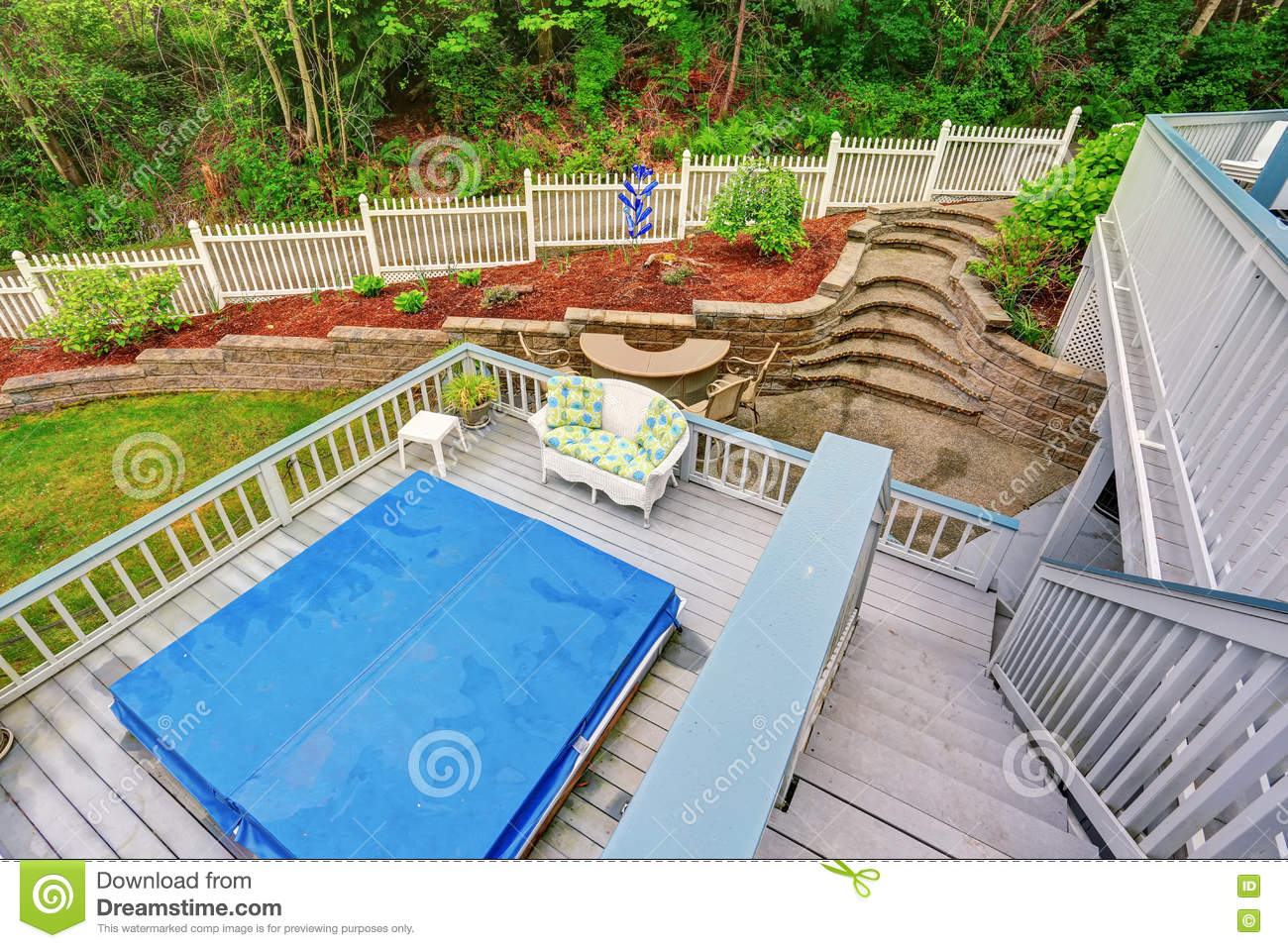 Two Level Backyard Deck With Jacuzzi On The First Floor