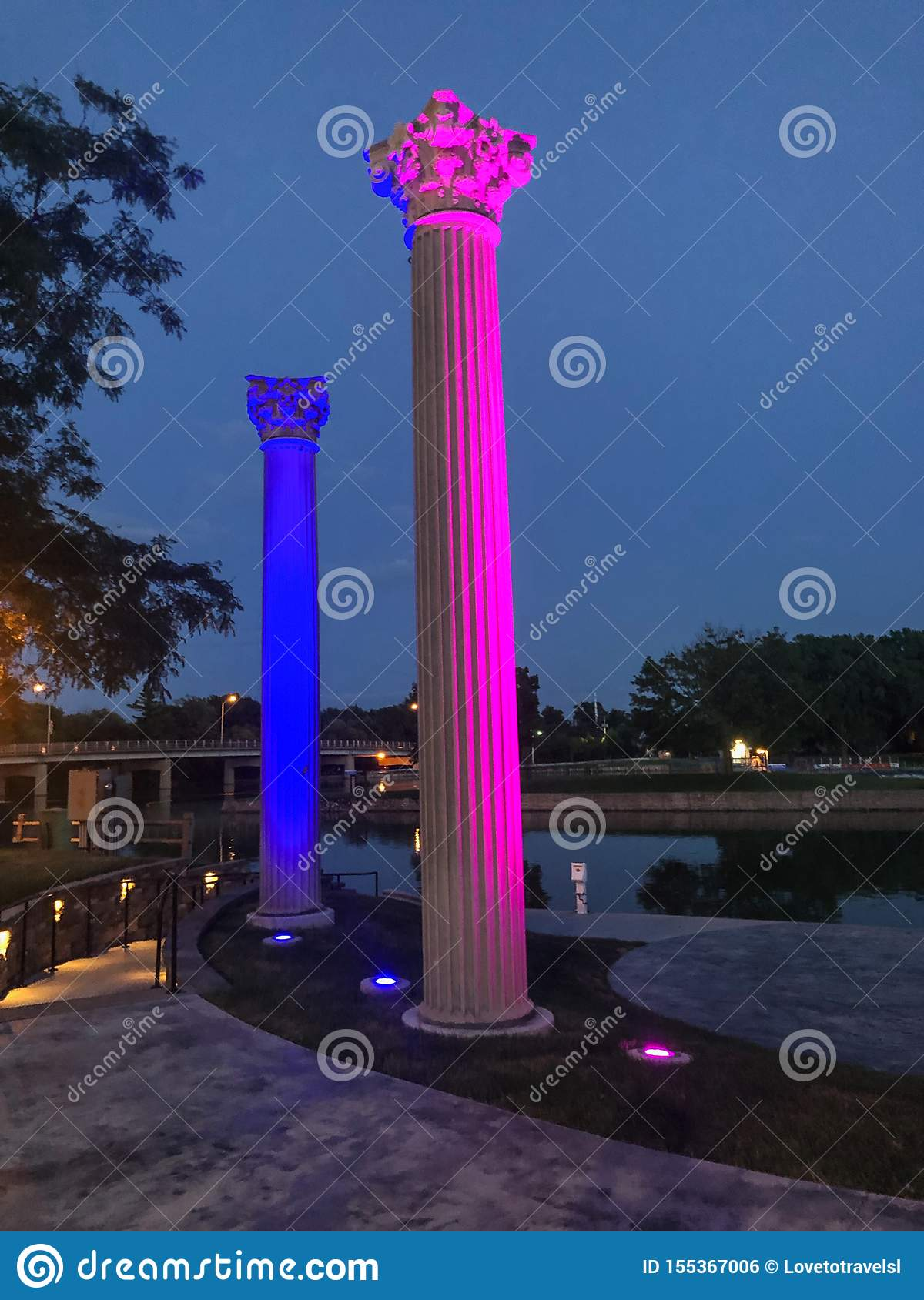 Two lighted pillars by water