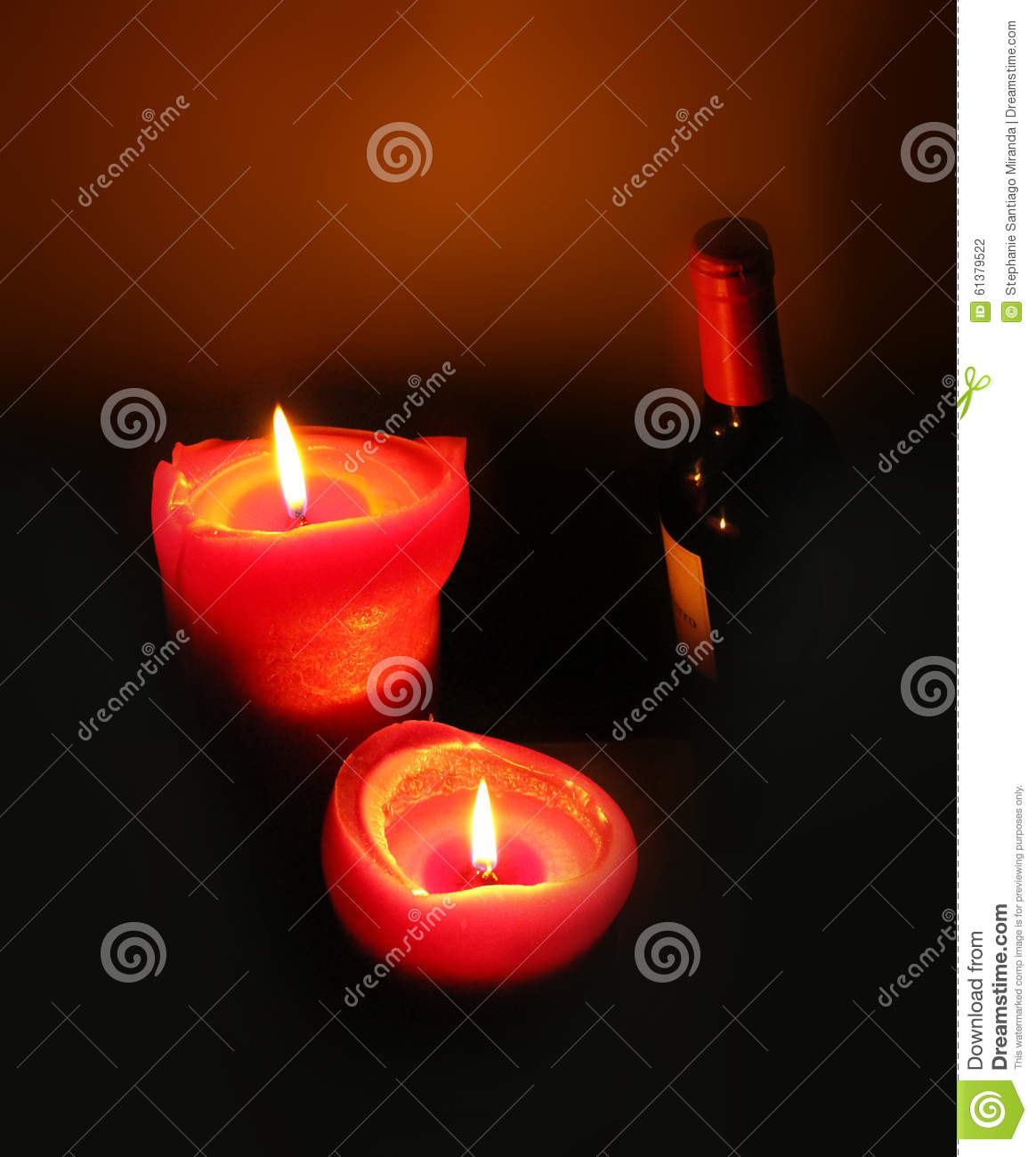 Two Lit Candles And A Bottle Of Red Wine Stock Photo - Image: 61379522