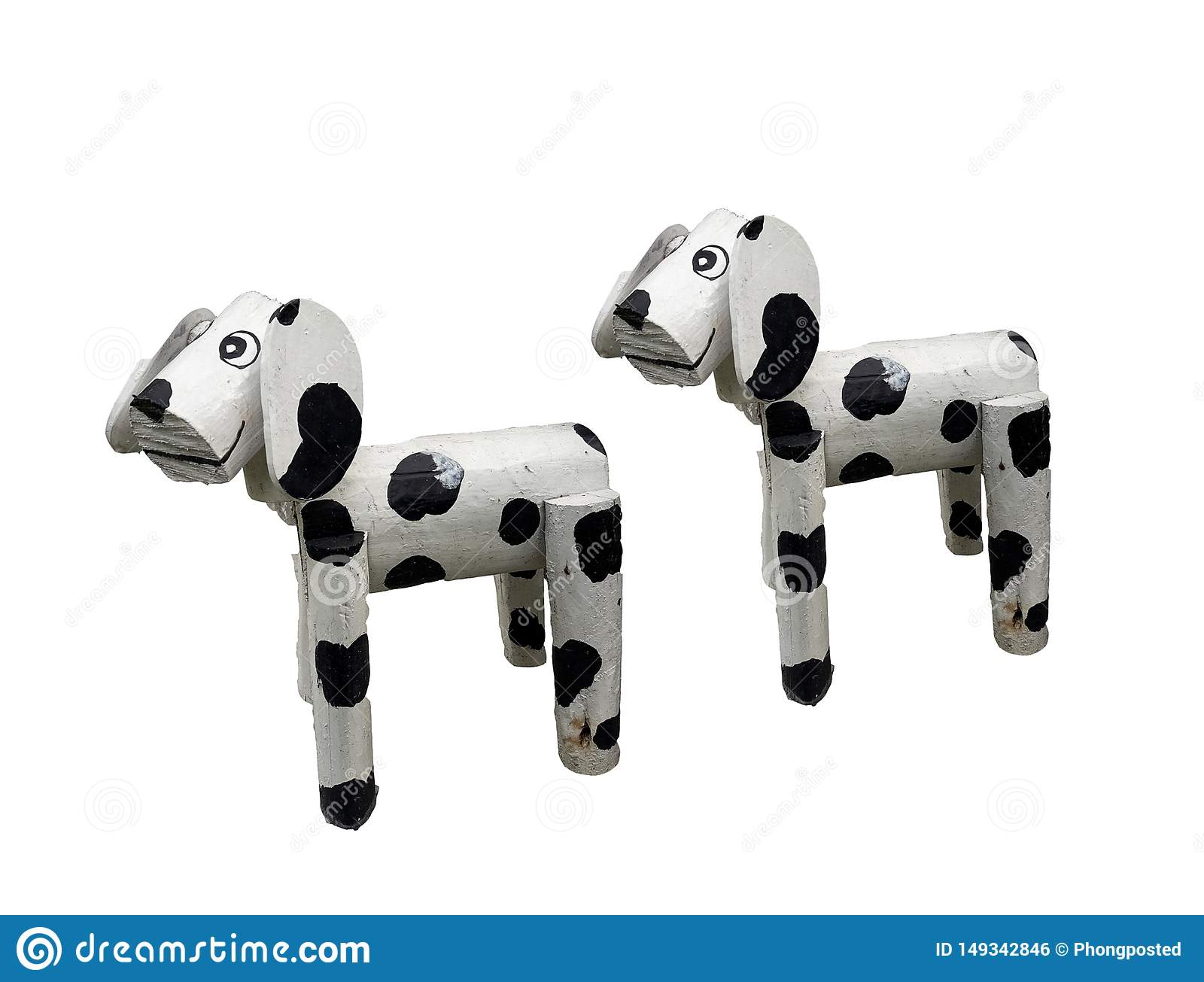 Two of litle wooden dogs white mixed black colored standind isolated on white background
