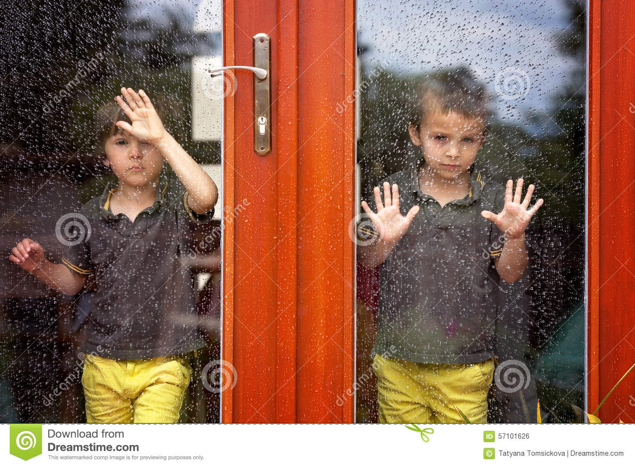 Two Little Boy Wearing Same Clothes Looking Through A Big Glass