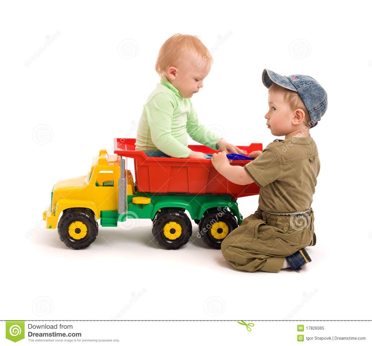 Toy Trucks For Boys : Little boys play with toy truck stock photography