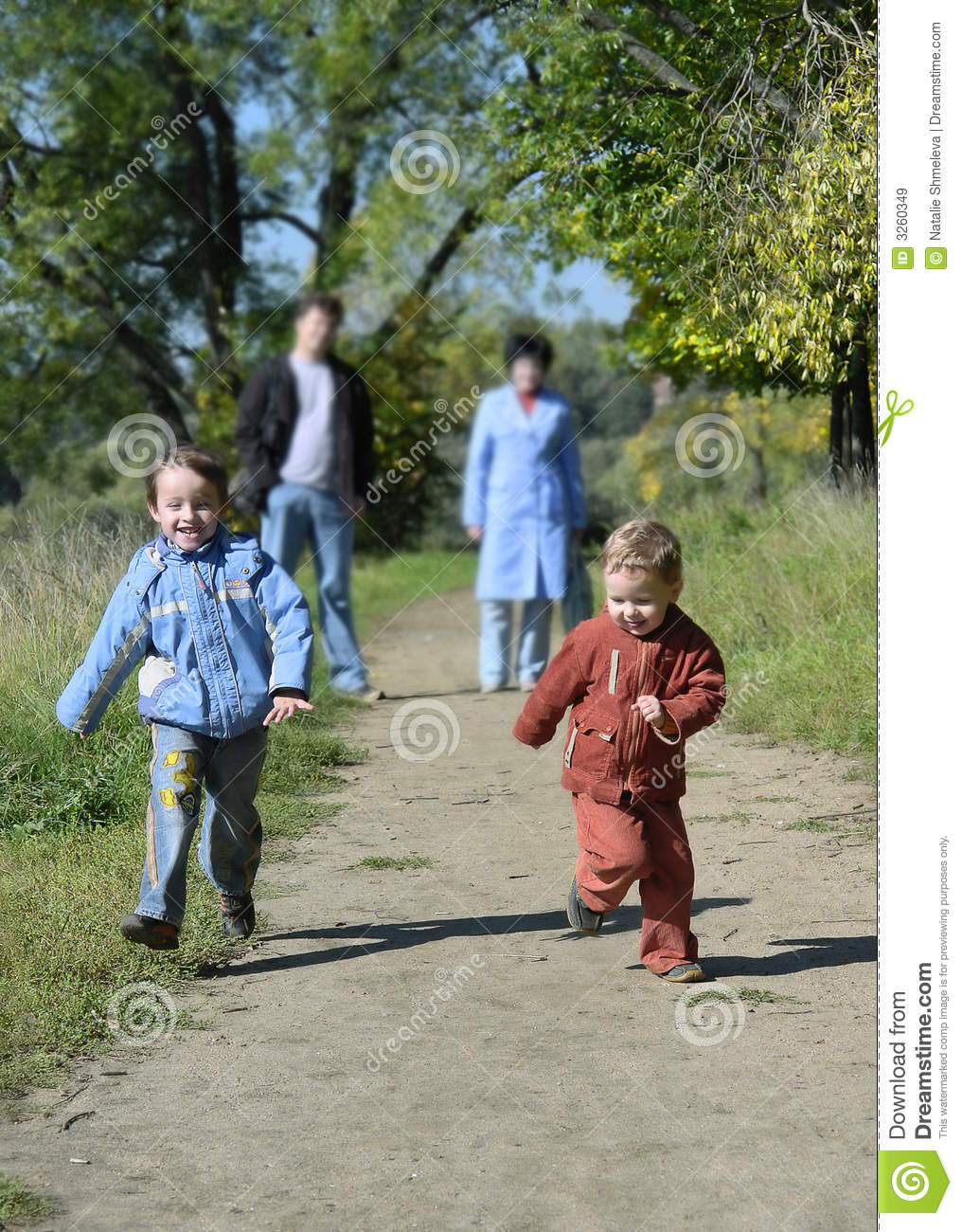 Two little boys running stock image. Image of color, colorful - 3260349