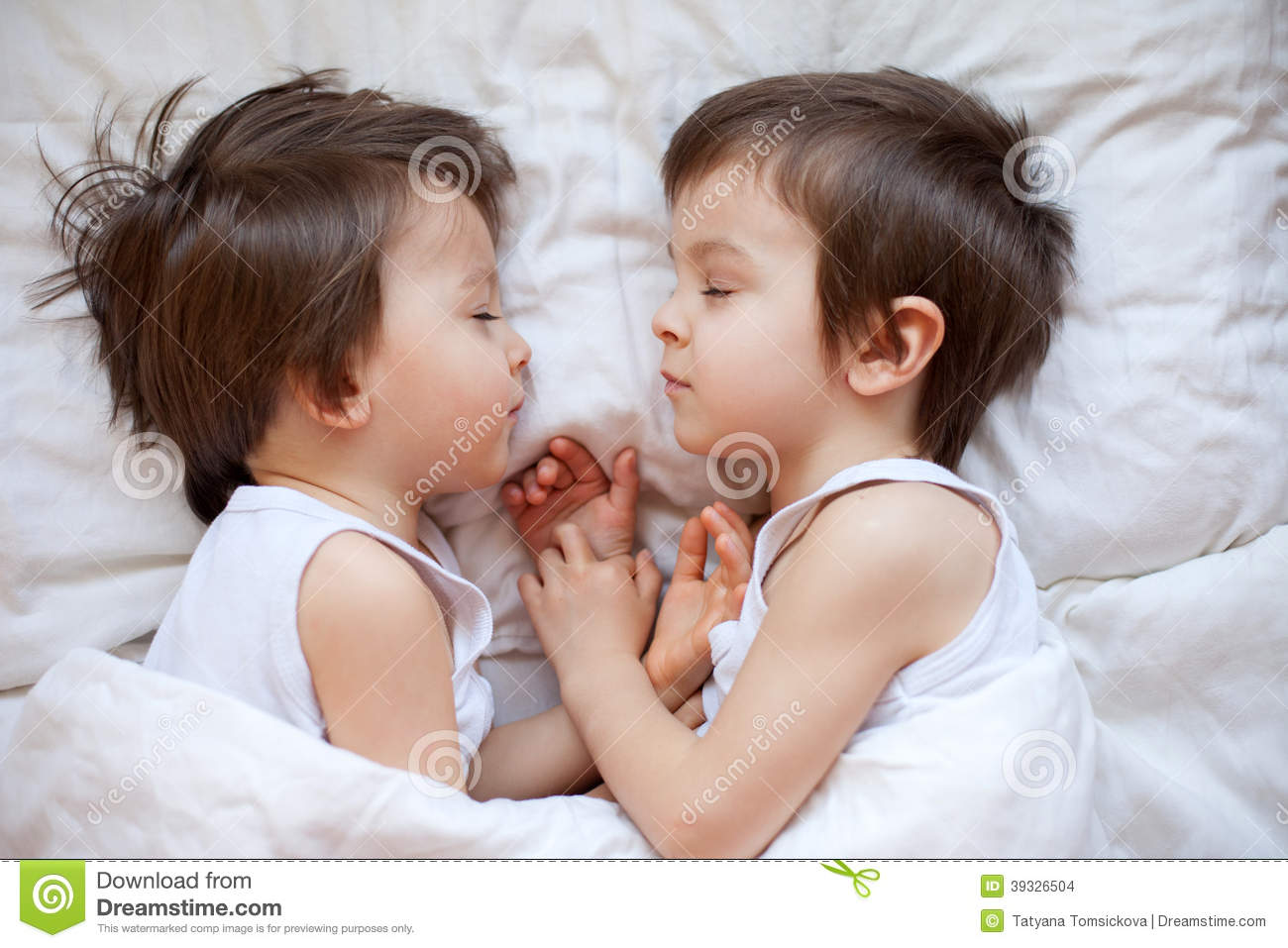 Two Little Boys Sleeping In The Afternoon Stock Photo