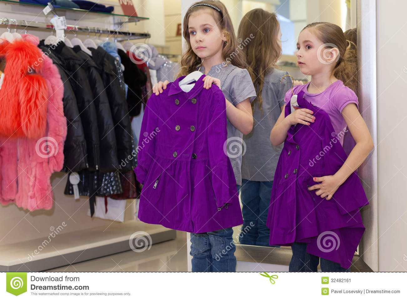 Two little cute girls near a mirror try on clothes stock for Mirror warehouse near me